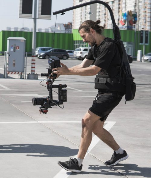 Image of our staff at Orlando Elite Video shoowing some footage out in a parking lot.